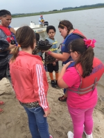Students learning about horseshoe crabs during a boat trip.