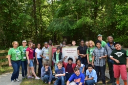 Students measure creek erosion in Hogtown Creek (located in Loblolly Woods)